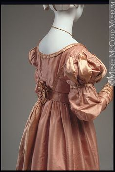 """1823-25. . Montrealers were known to enjoy dancing, for which a dress of this type would have been worn. To enable them to perfect this art, Madame Harries from Paris was operating a Dancing Academy in the city in 1824. Through the Canadian Courant and Montreal Advertiser of May 8, 1824, she announced the teaching of """"a number of the most fashionable Quadrilles, which are now practiced in Paris, and which have never been introduced in this city""""."""