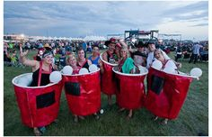 Toby Keith fans (left to right) Allysa Lougheed, Amy Corrigan, Travis Geislinger, Louis Lavallee, Kody Kwiatek, Rhiann Lougheed, Mike Semeniuk, Riley Bezjack and Liana Laberge wait for a coming storm to pass before Keith performs on the main stage at the Big Valley Jamboree in Camrose, Alta. on August 4, 2012.