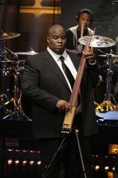"""Laser focus. Current GRAMMY nominee Salaam Remi keeps his eye on the prize during a performance on """"The Tonight Show With Jay Leno"""" on Jan. 7 in Burbank, Calif."""