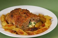 Meatloaf Barese style... with potatoes, provolone and mortadella. - See more at: http://www.cookingwithnonna.com/italian-cuisine/meatloaf-polpettone-barese2.html#sthash.5CYDbMIY.dpuf