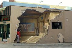 At first sight, this may seem like a cracked wall with a woman surveying the damage...but did you know that this actually is a 3D wall painting?! Pretty cool isn't it?