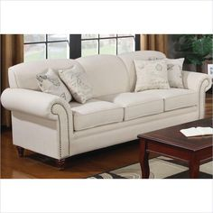 Coaster Norah Antique Inspired Sofa with Nail Head Trim in Oatmeal - 502511