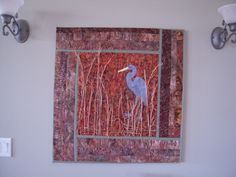 Created by: http://crookedgulleyartquilts.blogspot.com The quilt that started it all! My very first art quilt... it is appliqued, but no free motion quilting or thread sketching. The grasses are just that! Dried autumn weeds from the field across the street that I glue gunned on to the quilt. I would love to take it off of the frame and vastly improve it. Dear husband will have none of that! He loves it.