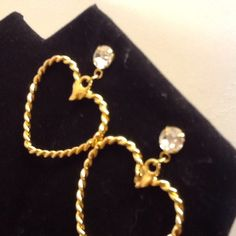 Avon pierced ear rings heart shaped w/diamond bead This is a pair of heart full hoop pierced earrings with surgical steel post. Heart shaped diamond looking bead on the top. Never used. In box. The box has a dent. Heart has a rope look. Vintage 1992. Avon  Accessories