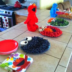 Cookie Monster - Grapes and Blueberries, Elmo - Tomatoes, Carrots, Olives, Oscar - Broccoli, Olives