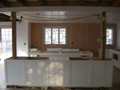 kitchen island with columns | The wall has been removed and the support posts placed. The cabinetry ...