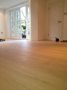 Client: Private Residence In East London Brief: To supply and install wood flooring in the client's living room.