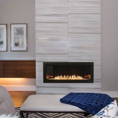 Bring remarkable style and functionality to your home with the Empire Boulevard Contemporary Ventless Gas Fireplace - 36 Tiled Fireplace Wall, Tile Around Fireplace, Basement Fireplace, Linear Fireplace, Wall Mount Electric Fireplace, Fireplace Built Ins, Bedroom Fireplace, Home Fireplace, Fireplace Remodel