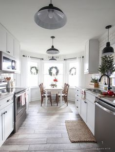 A beautiful farmhouse kitchen decorated for the holidays! Table at the front of the house!