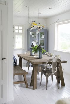 Kitchen with wood tables and white floor.