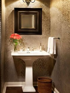 The Tone On Patterned Wallpaper Define This Elegant Bathroom A Dainty Pedestal Sink And Small Mirror Keep Focus Subtle Yet Shimmering