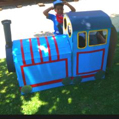 Thomas the Train made out of cardboard boxes, poster board and duck tape.