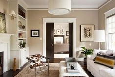beige living room with white accents (Sherwin Williams, Bona Fide Beige)