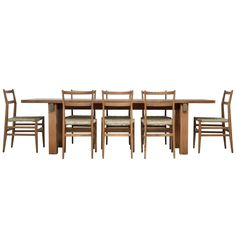 Charlotte Perriand Brazil Table with Eight Gio Ponti Leggera Chairs   From a unique collection of antique and modern dining room chairs at https://www.1stdibs.com/furniture/seating/dining-room-chairs/