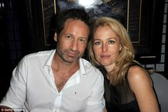 Reunited: Davd Duchovny and Gillian Anderson, who co-starred in The X-Files TV series and it's film sequels, got a chance to reacquaint at Comic Con in San Deigo, CA on Thursday