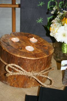 Log candle holders are easy to make and beautiful to include in your rustic wedding decor.