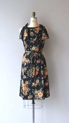 Vintage 1970s black floral print polyester dress with tie flutter sleeves, tent shape (no waist band), tie belt and back zipper. ✂-----Measurements