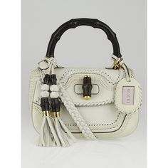 Pre-owned Gucci White Handstitched Leather New Bamboo Medium Top... ($2,500) ❤ liked on Polyvore featuring bags, handbags, leather handbags, white leather handbags, white handbags, real leather purses and top handle leather handbags
