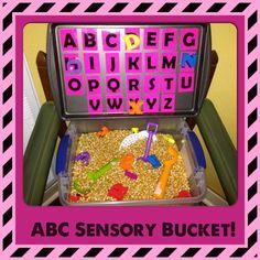 ABC letter sort in sensory bend! Materials: popcorn kernels, magnetic letters, cookie sheet, plastic bend, paper!