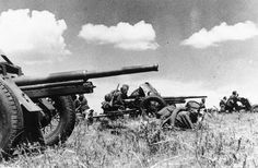 Antitank gun crews of the Red Army prepare to fire against approaching German tank units, on an unknown battlefield, on October 13, 1942, during the German invasion of the Soviet Union.