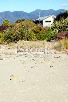 Kiwi Bach by the Beach Royalty Free Stock Photo Kiwiana, Beach Photos, Image Now, New Zealand, Royalty Free Stock Photos, Places, Water, Outdoor, Gripe Water