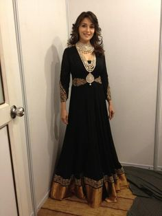 Madhuri Dixit looks gorgeous in this beautiful black floor length outfit at the Jewelry Couture Week, India. Beautiful Black Dresses, Pretty Dresses, Beautiful Outfits, Designer Anarkali, Indian Attire, Indian Wear, Pakistani Outfits, Indian Outfits, India Fashion