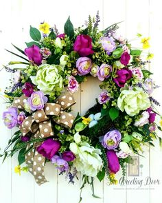 This beautiful full floral wreath will look amazing on your front door this spring!