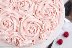 Raspberry Rose Cake is made up of two tender white cakes with sweet raspberry jam sandwiched between and then covered in rose-like swirls of silky smooth raspberry cream cheese frosting. It's the perfect cake for Valentine's Day, a bridal shower, a baby shower... or any time you need a yummy pink cake!