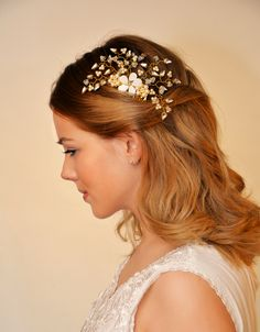 The daisy wedding headpiece bridal hair comb - This beautiful handmade bridal hair vine comb is made with Swarovski crystal and pearl with a central Mother of Pearl flower entwined and suspended amongst Gold or Silver wire. Versatile to suit any hairstyle. Delicate crystals and pearls have been hand woven into small pretty 3 leaf flowers to give an exquisite sparkle. Options for silver or gold colour. £72