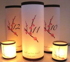 pretty idea for table numbers/center decor  pink-cherry-blossom-table-numbers-lumniaries