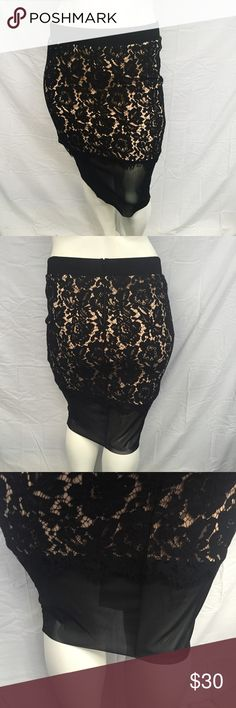 Torrid Lace and Mesh Miniskirt Sweet and sexy miniskirt from torrid! This features a black lace overlay over a blush pink panel. Mesh layer on the bottom. Zippered back with a hook and eye. Stretchy waistband. New with tags, never worn. Smoke and pet free home. A torrid size 0 is the equivalent of a 0X. torrid Skirts Mini