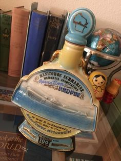 """Wow what a great man cave piece celebrating the amazing efforts of the USS Redfin in WWII!!! This is Jim Beam Bourbon Whiskey Decanter from 1970 created by James B. Beam Distilling Company KY-DR8-230. C Miller. There are no cracks or chips and the bottle is empty with original cap and cap sticker. Genuine Regal China, stands 11 1/4"""" tall, 7.5"""" across, and a depth of 2"""" on the base. This would look great on a shelf in your rockin man cave or make a great bachelor party gift..."""