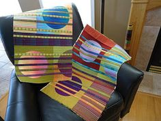Neat idea sewing strips of striped fabrics on top of background blocks with appliqued circles - Kaffe Fasset fabrics.  Modern runner coming up.