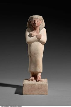 Statuette of Intef, Son of Sitmehyt, Standing Period: Middle Kingdom Dynasty: Dynasty 12 Date: ca. 1981-1802 B.C. Geography: From Egypt, Upper Egypt; Thebes Medium: Limestone, paint