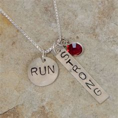 "Looking for a great gift to help your favorite runner stay motivated? We paired our handmade, hand stamped, sterling silver personalized sterling silver 1/2 inch ""run"" charm with our rectangle ""strong"" charm to create a unique running necklace."