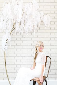 DIY wisteria backdrop - photo by Emily Chidester Photography http://ruffledblog.com/best-of-2014-diy #diyproject #weddingdiy