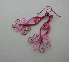 Pink Peacock Wire Swirl Earrings -- Red, Pink, Magenta Wire Spiral Earrings with Peacock Tail. $43