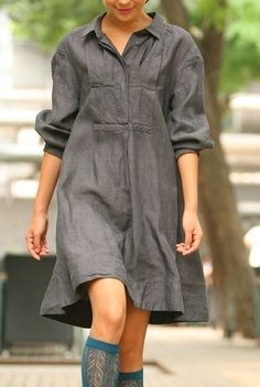 Linen dress.  I love linen, cotton, silk clothing.  Will put up with ironing and dry cleaning to wear natural fabrics.