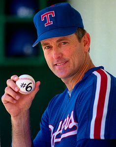 Nolan Ryan, pitcher for the Texas Rangers, poses with the game ball from his sixth career no-hitter.  That's a lot of no-nos.