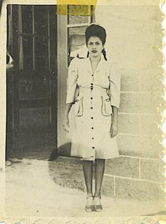 1940's Chicana.  Love her dress and hair!