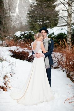 Image by Helen Cawte Photography. - A Snowy Winter Wedding With A Jenny Packham Muscari Dress And Navy Bridesmaid Dresses And A White Rose Bouquet In Chamonix France Photographed By Helen Cawte.