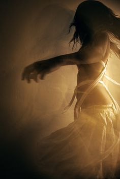 Her golden dress followed her as she twirled, and in that moment I realized she was too beautiful for me to kill.