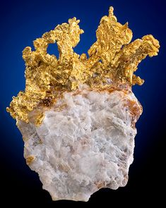 Fine specimen of crystalline Native Gold on Quartz matrix. From the Eagle's Nest Mine, Placer County, California.