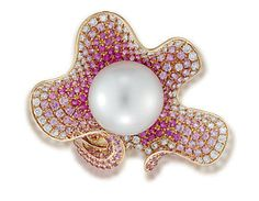 A CHARMING SOUTH SEA CULTURED PEARL, SAPPHIRE AND DIAMOND RING, BY ANNA HU Of abstract floral design, the ring mounted with a 14.55mm round cultured South Sea pearl to the pavé-set diamond and pink sapphire surround with similarly set half-hoop