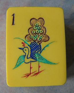 Mahjong tile. Love the shape. The new birds aren't so lovely as this vintage one is.