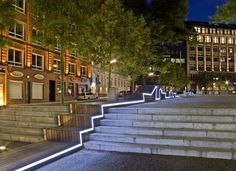 Kontor Freiraumplanung created in Hamburg, a long bench that runs through public space in its entire length while illuminating the evening.