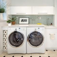 modern laundry room by Josephine Design LLC I like that the above cabinets open upwards
