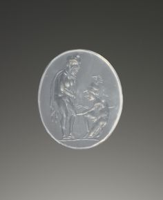 Engraved Gem; Unknown; Italy; 1st century B.C.; Translucent white chalcedony; 1.4 x 1.2 x 0.2 cm (9/16 x 7/16 x 1/16 in.); 85.AN.370.44. Gem engraved with the image of Philoktetes, bearded and wearing a cloak, leaning on a staff while his leg is bandaged by the kneeling figure of Machaon. Machaon is nude with plumed helmet and sword.