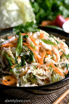 An easy Asian Slaw salad with the most fantastic dressing! This is perfect as a side dish to any Asian meal, with grilled meats or seafood, or on tacos.