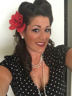 Pinup hair and makeup, victory rolls, winged eyeliner, red lips